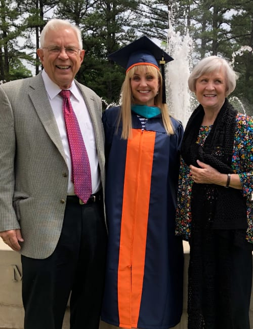 Residents and their granddaughter at her graduation near Inspired Living Alpharetta in Alpharetta, Georgia.