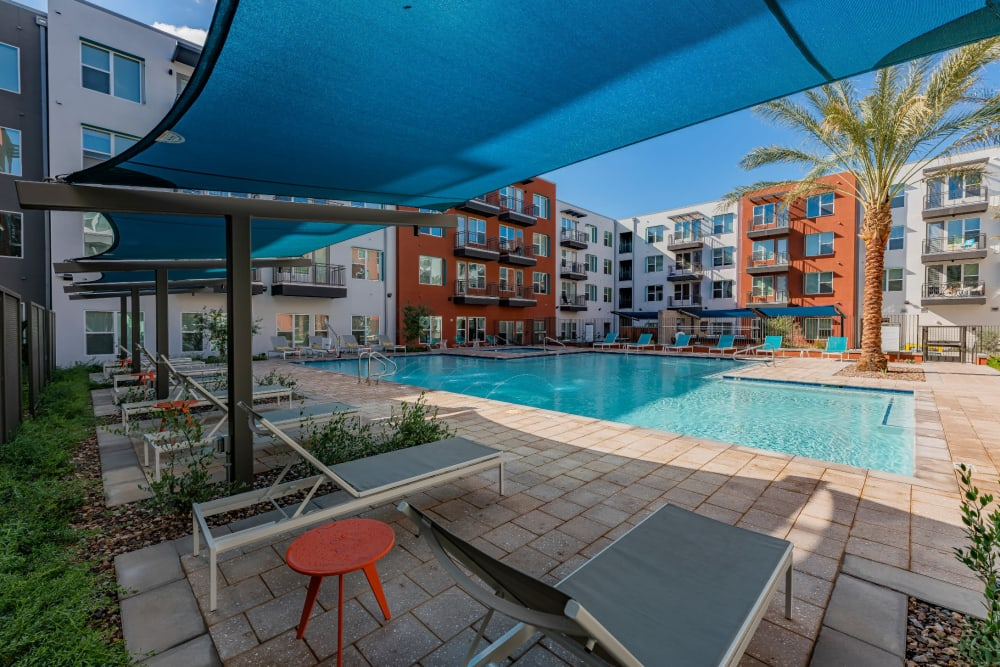 Resort-style, sparkling swimming pool at Encore Tessera in Phoenix, Arizona