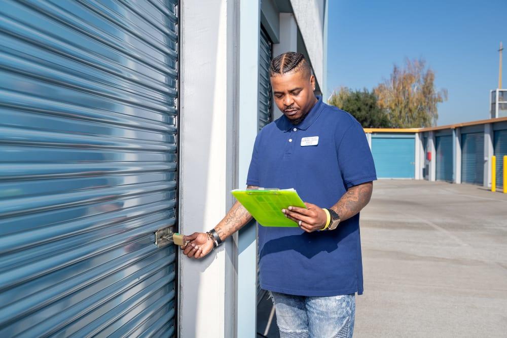 An employee checks the lock at Castro Valley Hayward Storage LLC in Castro Valley, California