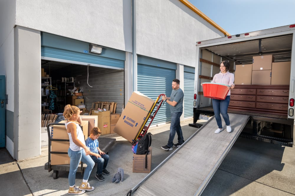 A family unloading a moving truck at Castro Valley Hayward Storage LLC in Castro Valley, California