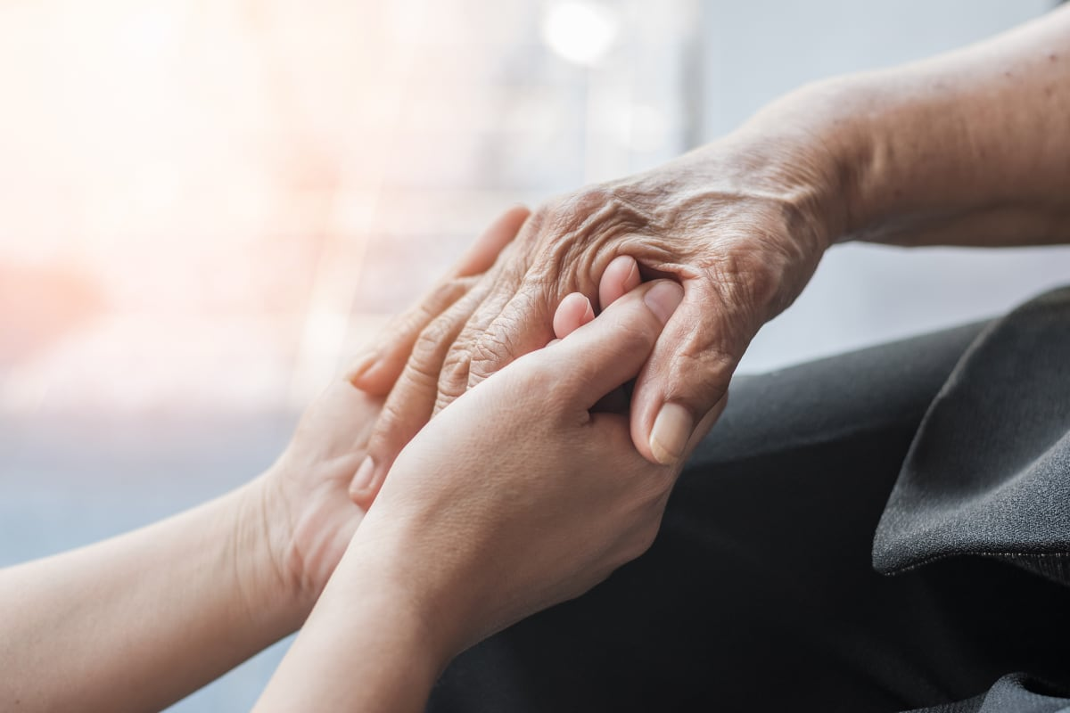 Holding hands at Lighthouse Memory Care in Anacortes, Washington