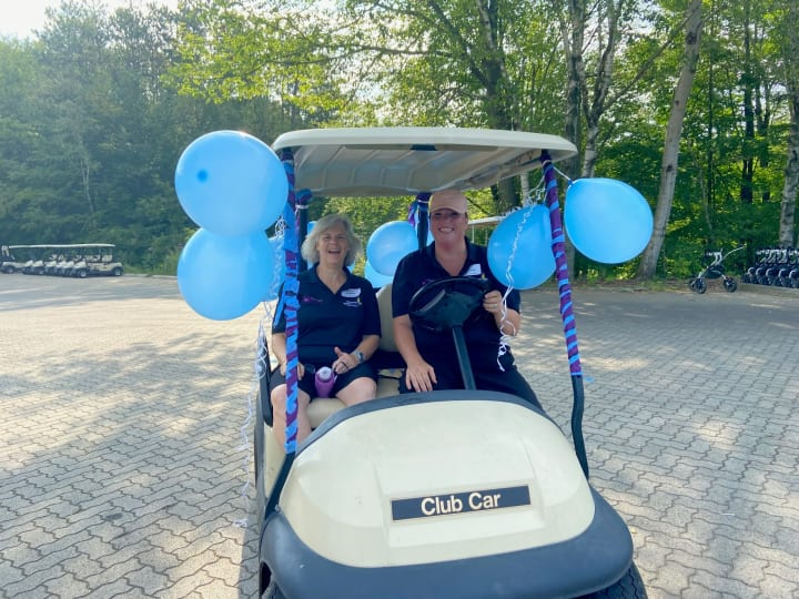 Smiles and golf carts at golf fundraiser for hospice