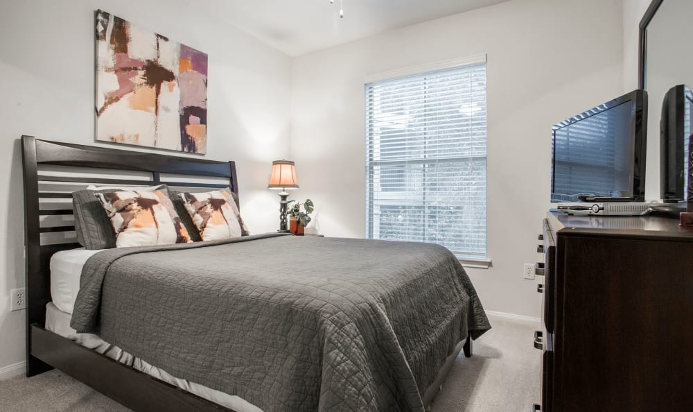 Spacious master bedroom in a model home at Riata Austin in Austin, Texas