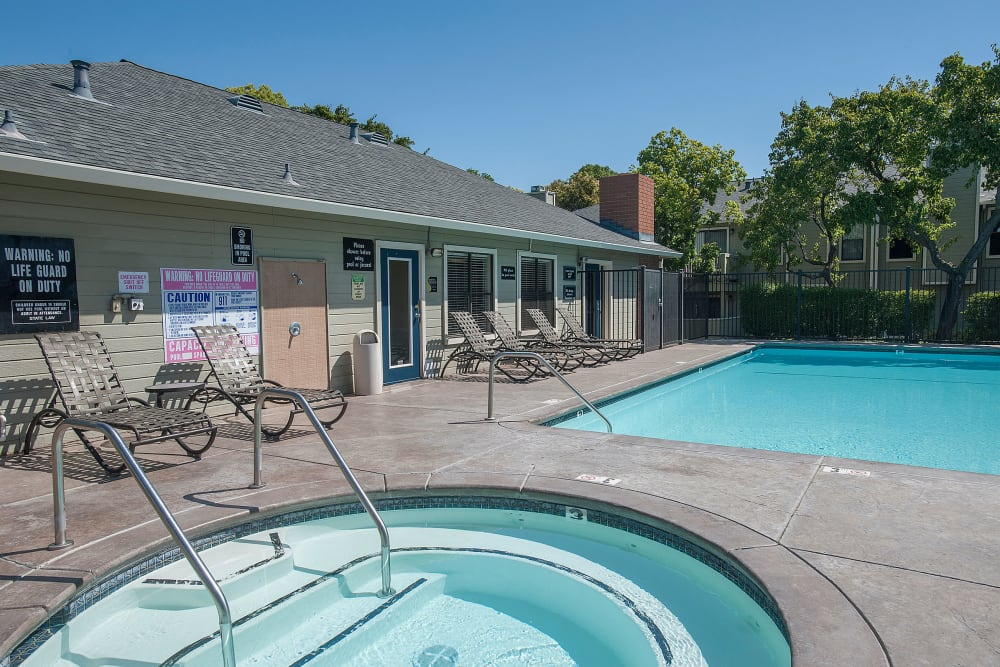 Resort-style spa and swimming pool at Sandpiper Village Apartment Homes in Vacaville, California