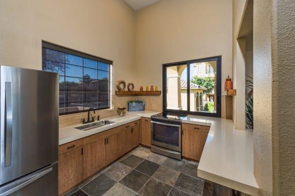 Model living room next to breakfast bar at Stone Oaks in Chandler, Arizona