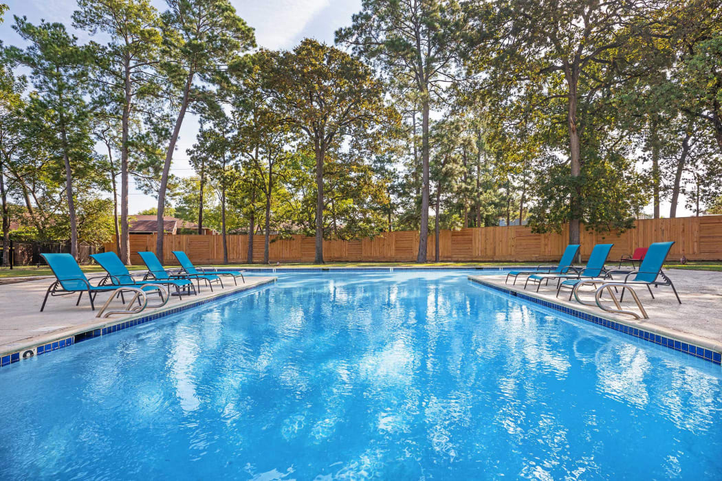 Sparkling resort-style swimming pool at Roundhill Townhomes in Houston, Texas