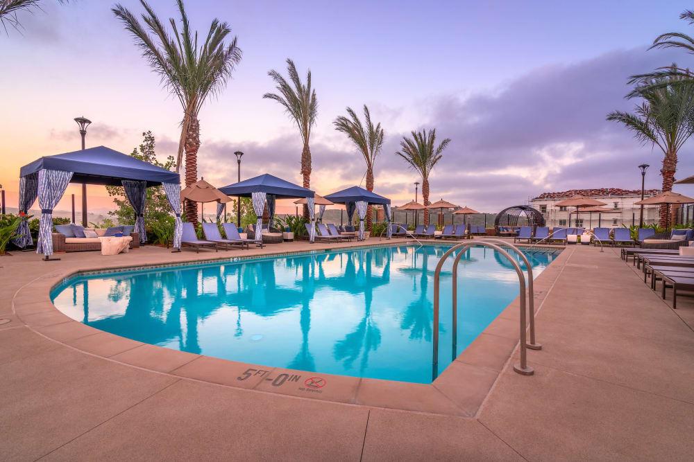 Swimming pool at sunset at Montecito Apartments at Carlsbad in Carlsbad, California