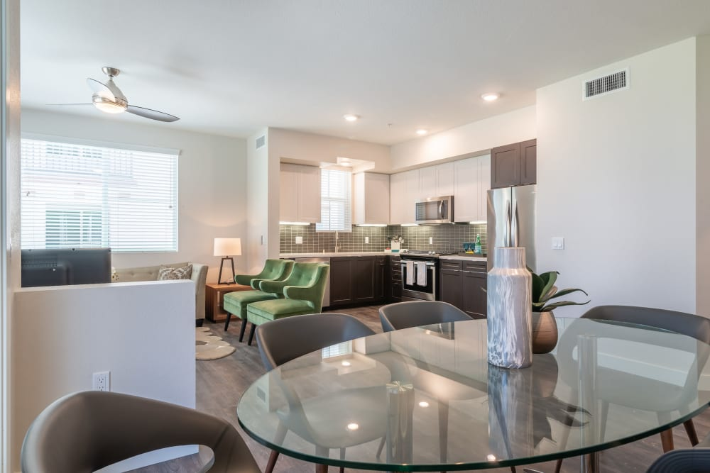 Beautiful dining room with glass table at Montecito Apartments at Carlsbad in Carlsbad, California