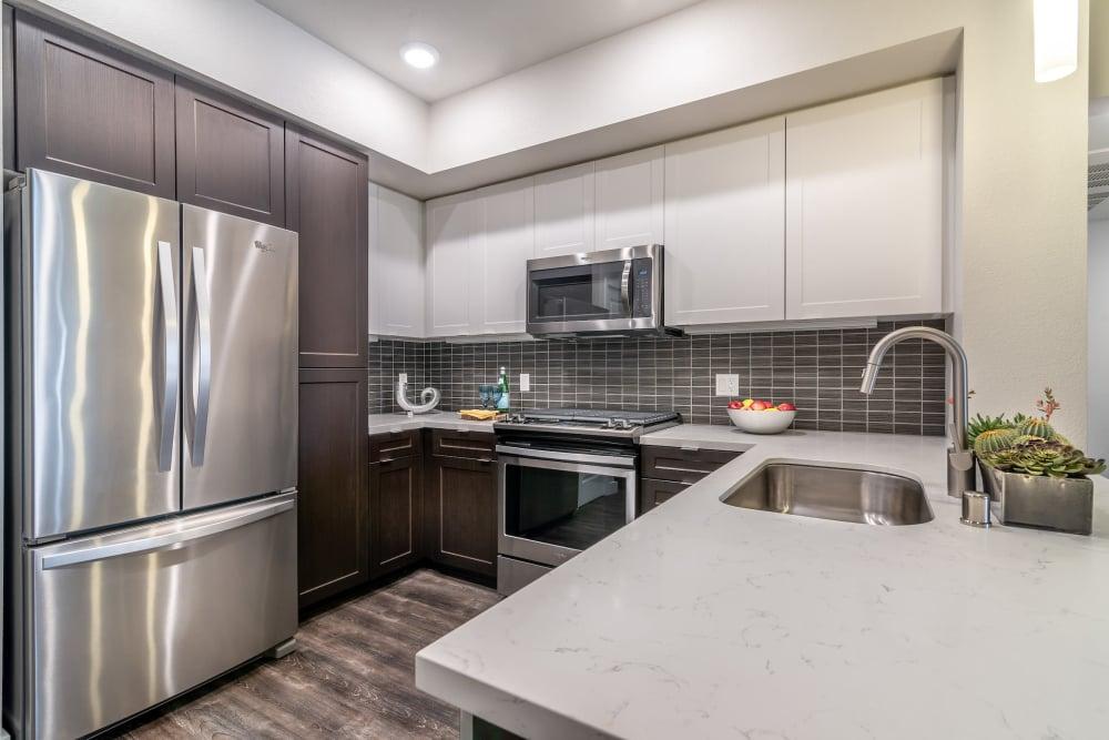 New renovated kitchen at Montecito Apartments at Carlsbad in Carlsbad, California