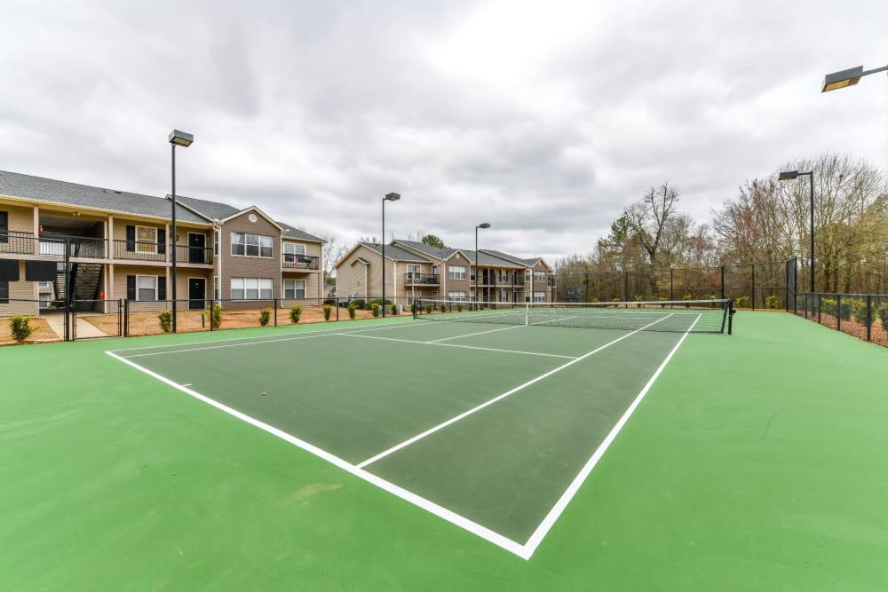 Lightened tennis court at 900 Dwell in Stockbridge, Georgia