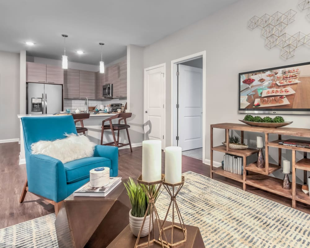 Comfortably decorated living space in a model home at The Palmer in Charlotte, North Carolina