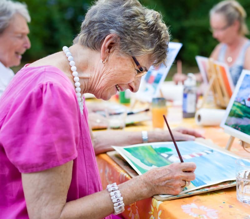 A resident painting at Carefield Living.