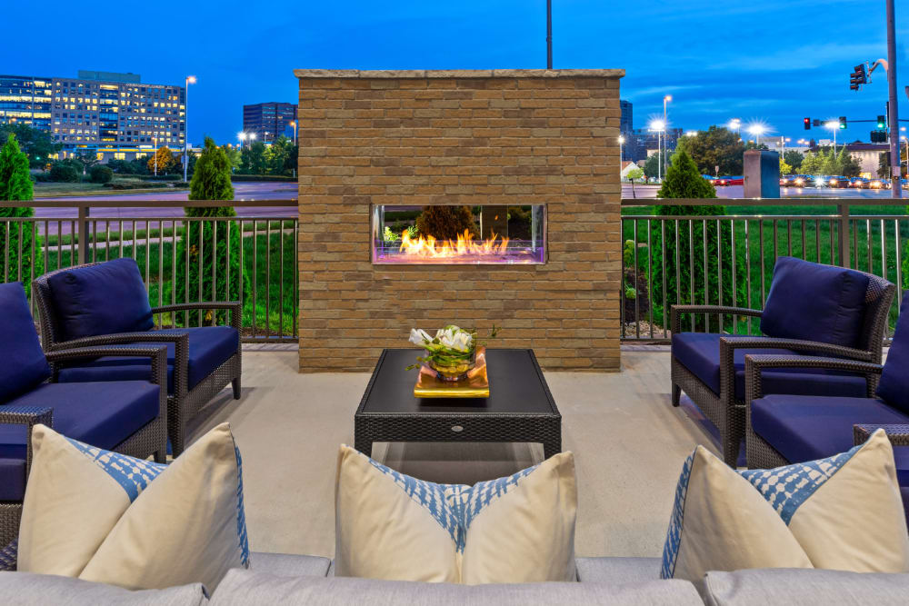 Outdoor seating by the fire at Anthology of the Plaza in Kansas City, Missouri