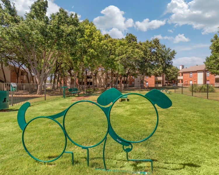 Spacious dog park with green grass at The Logan in Bedford, Texas