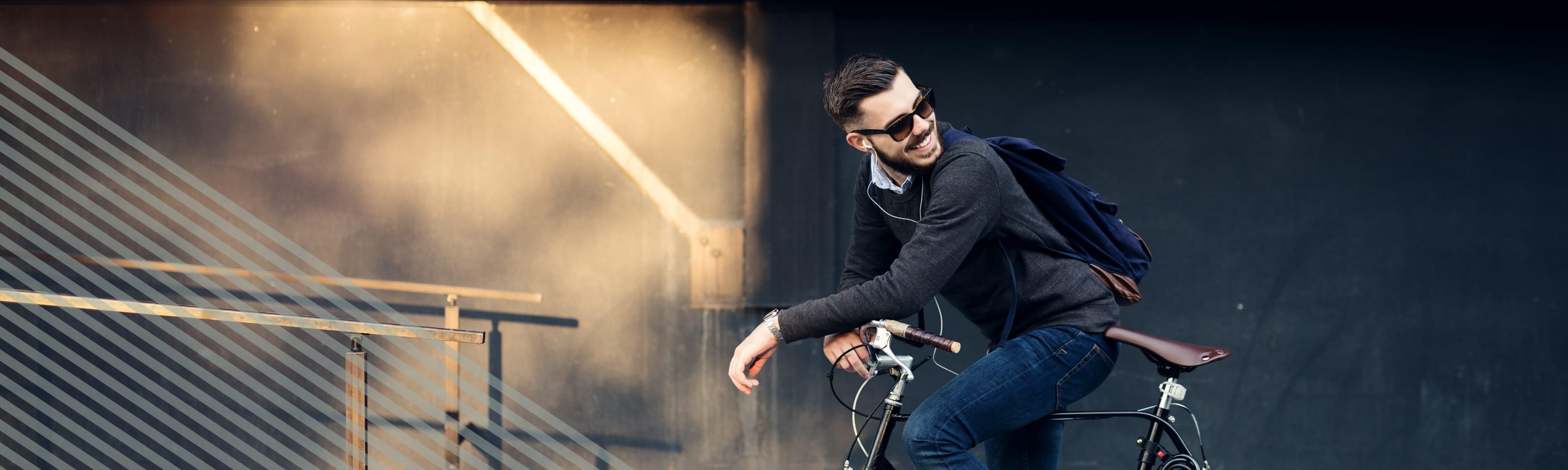 Man riding bike in Austin near Alta Tech Ridge