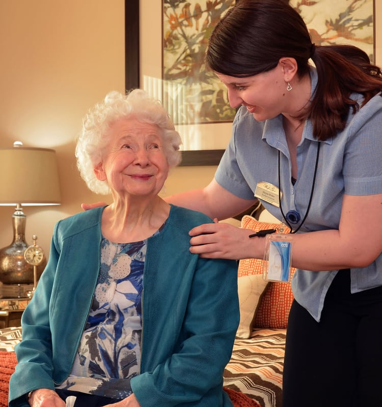Memory care staff member and senior woman at Heritage Springs in NV, Las Vegas