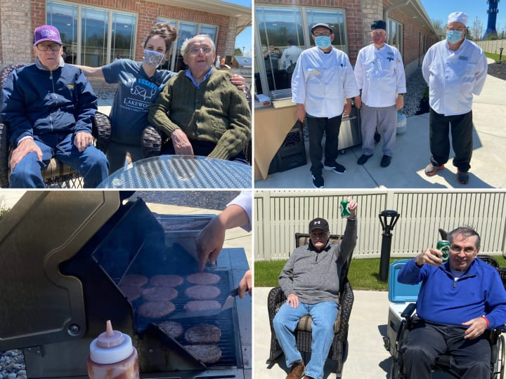 Food Service Team at Lakewood Alzheimer's Special Care Center hosting a cookout on the grill for residents and team members