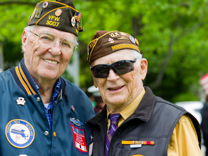 senior veterans posing together in their uniforms