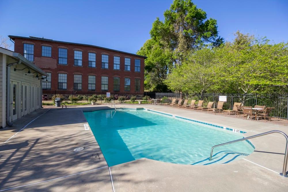 Swimming pool at Newnan Lofts Apartment Homes in Newnan, Georgia