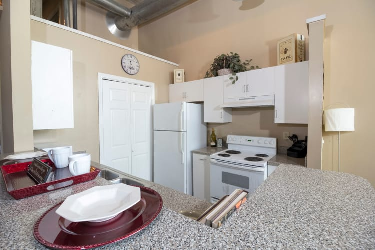 Fully equipped kitchen at Newnan Lofts Apartment Homes in Newnan, Georgia