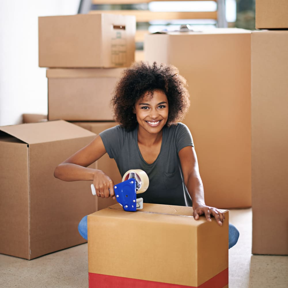 Woman packing up a box at Cliffdale Safe Storage in Fayetteville, North Carolina
