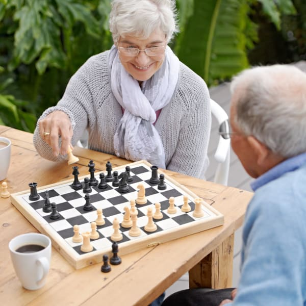 Residents playing chess at Pacifica Senior Living Fresno in Fresno, California.