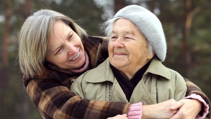 Adult Daughter Hugging Senior Woman