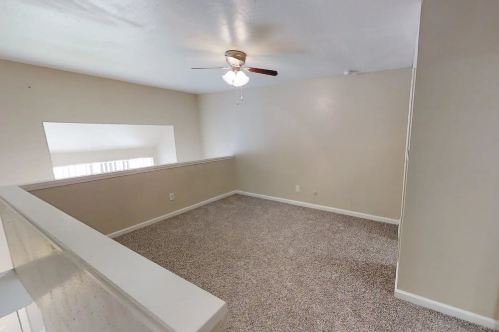 Carpeted upstairs at Falls of Maplewood Apartments in Houston, Texas