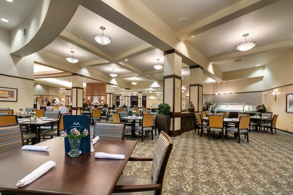 Dining hall with high ceilings at Merrill Gardens at Kirkland