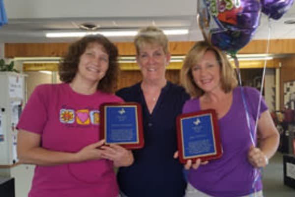 Caregivers receiving awards at Chestnut Knoll at Home.