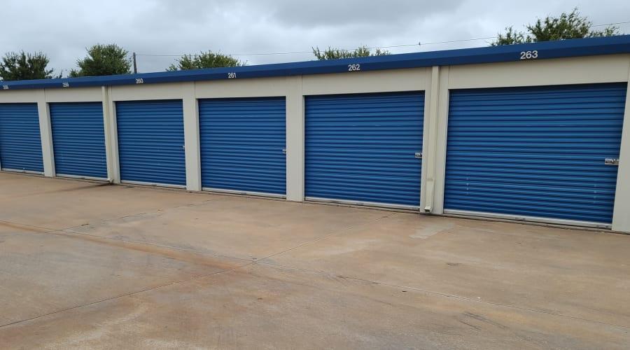 Outdoor storage units with blue doors at KO Storage of Wichita Falls - North in Wichita Falls, Texas