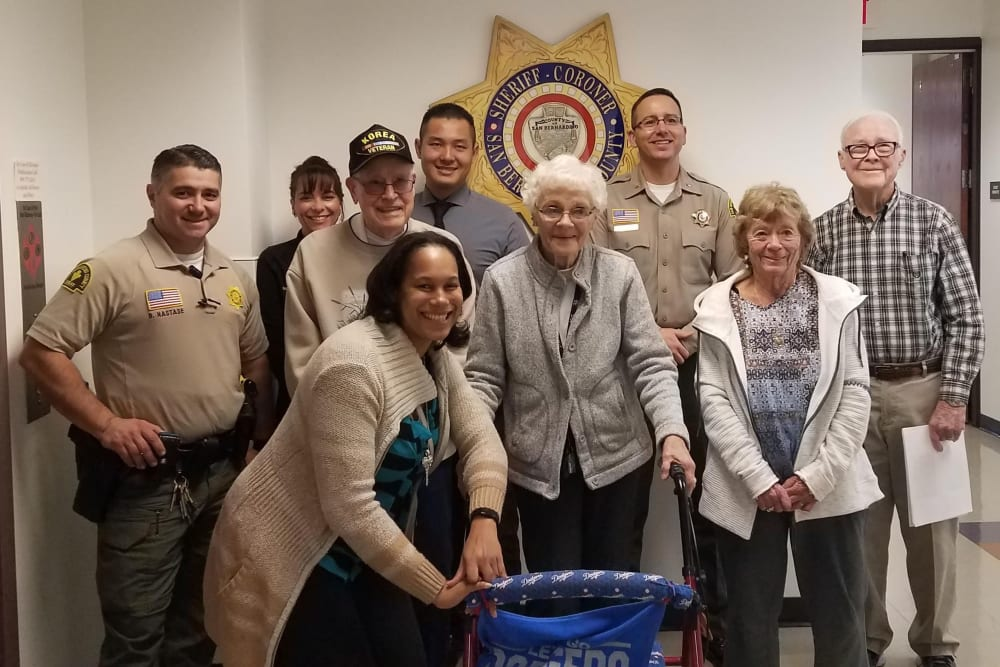 senior residents photo with veterans and police officers