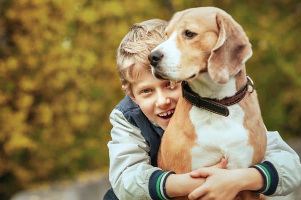 Kid hugging his dog at Lullwater at Riverwood in Evans, Georgia