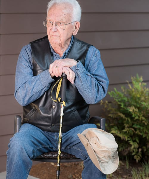 Resident sitting with his hiking gear on at The Springs at Tanasbourne in Hillsboro, Oregon