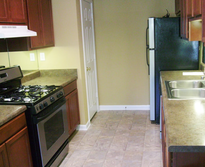 Modern kitchen with a gas range in a model home at Azalea Springs in Marietta, Georgia