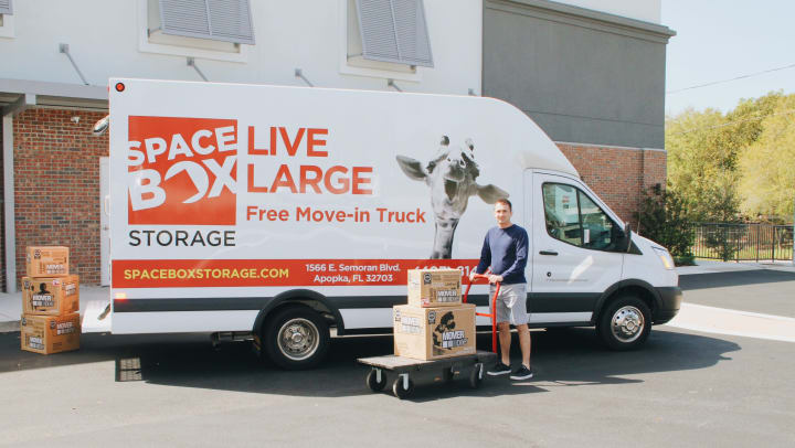 Man with Moving Truck in Front of Spacebox Storage