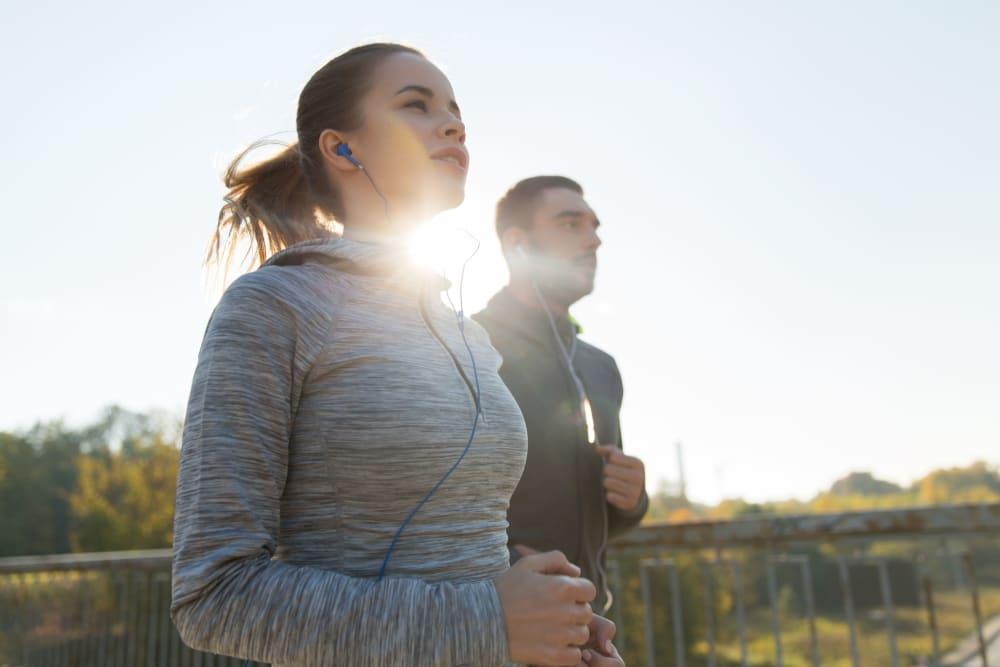 Residents jogging near River Walk Apartment Homes in Shreveport, Louisiana