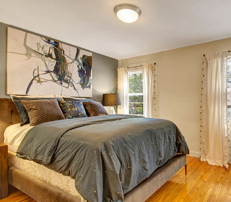 Well decorated spacious bedroom at Gardencrest in Waltham, Massachusetts
