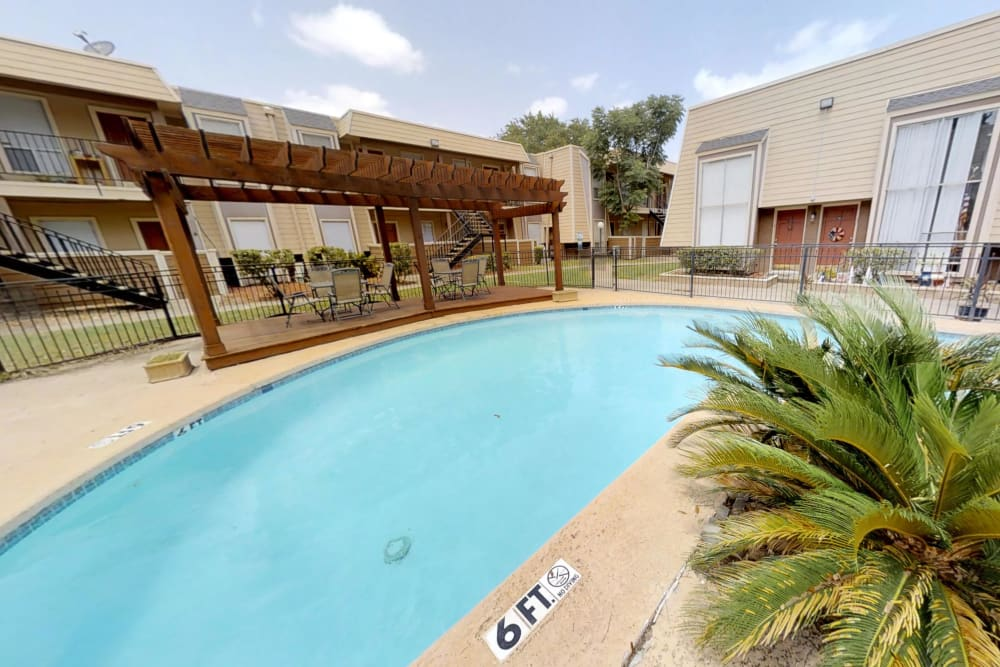 Large sparkling swimming pool at Falls of Maplewood Apartments in Houston, Texas