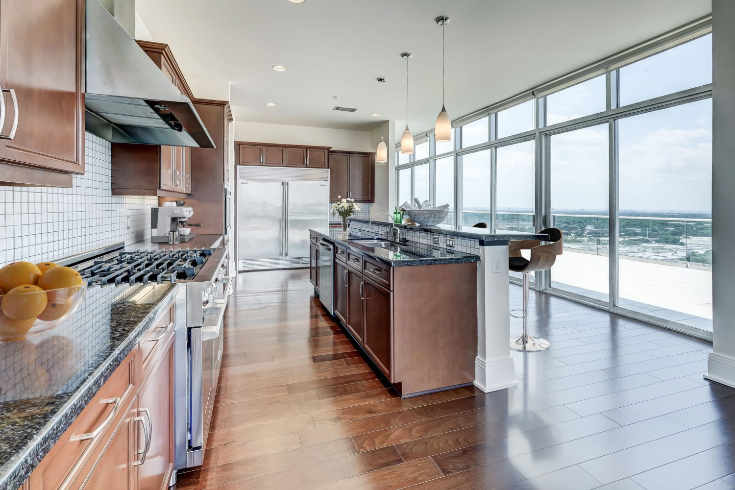 Sleek kitchen with stainless steel appliances at The Heights at Park Lane in Dallas, Texas