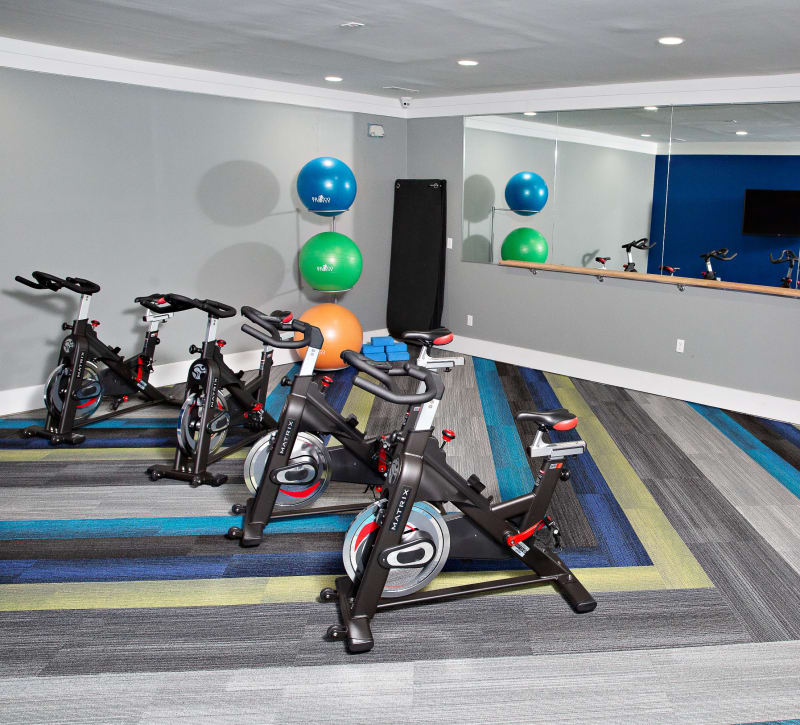A fitness center with plenty of spin bikes at 7029 West in Greensboro, North Carolina