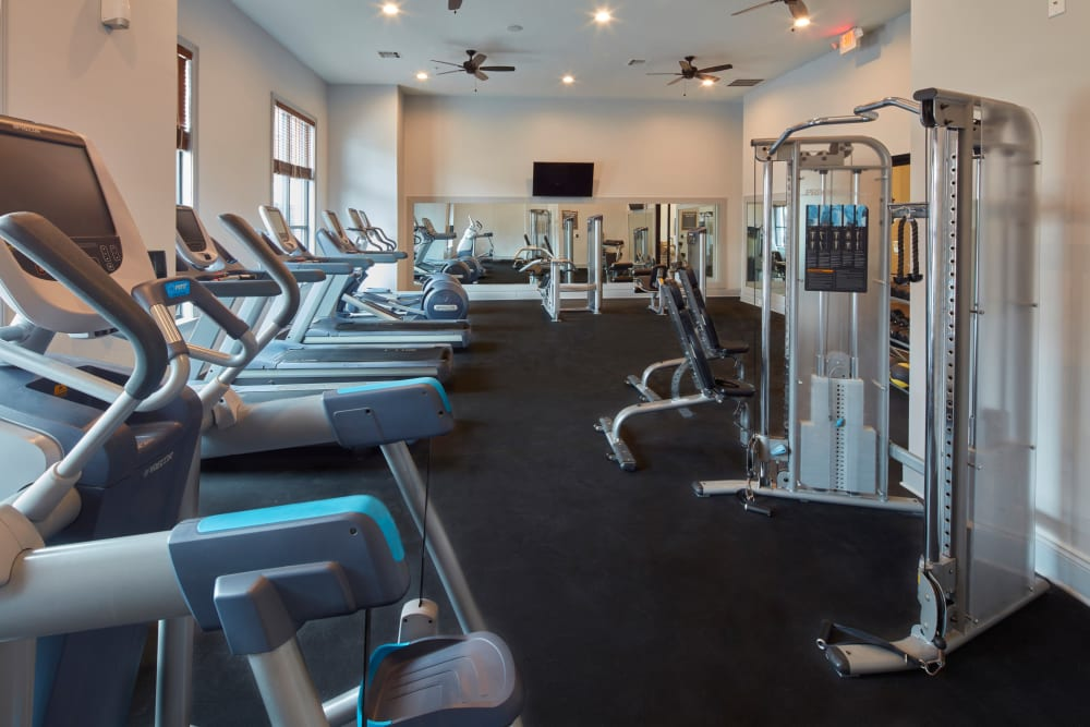 Cardio, free weights, and machines at Trifecta Apartments fitness center