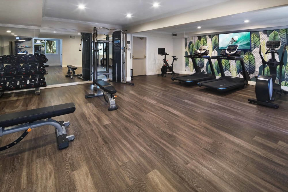 Onsite fitness center with plenty of cardio equipment at Haven Warner Center in Canoga Park, California