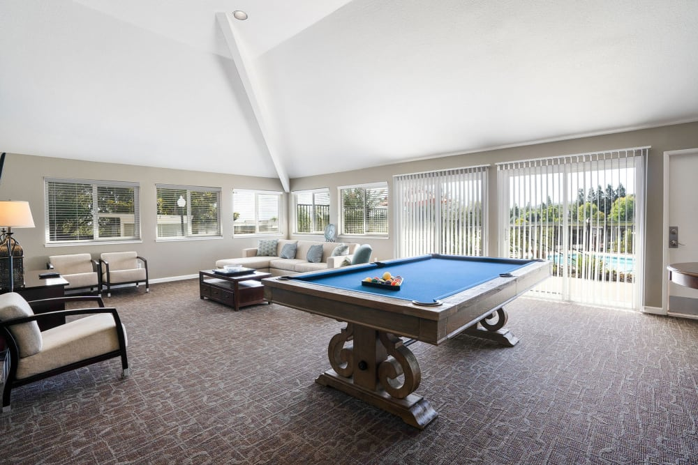Clubhouse with a billiards table and comfortable seating at Ridgecrest Apartment Homes in Martinez, California