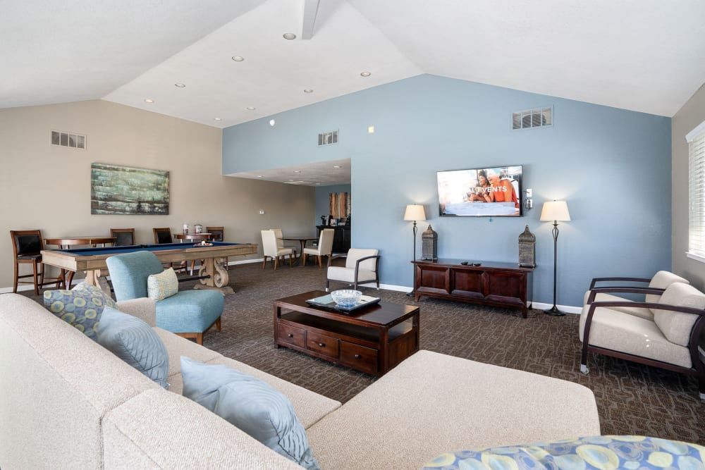Clubhouse with a flat-screen TV at Ridgecrest Apartment Homes in Martinez, California