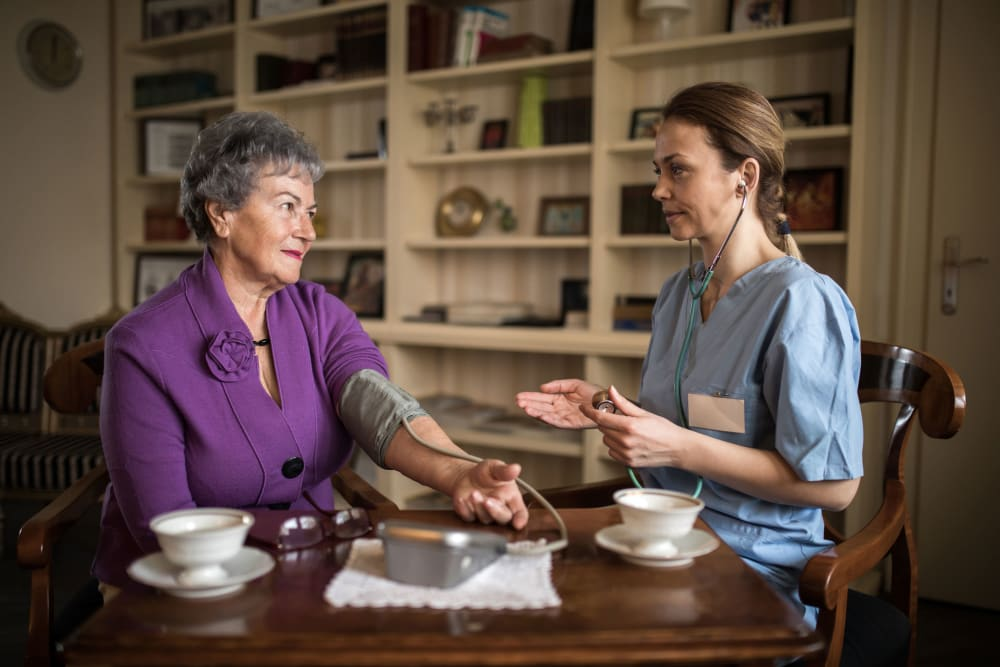 Resident consulting with site nurse at Westminster Memory Care in Lexington, South Carolina
