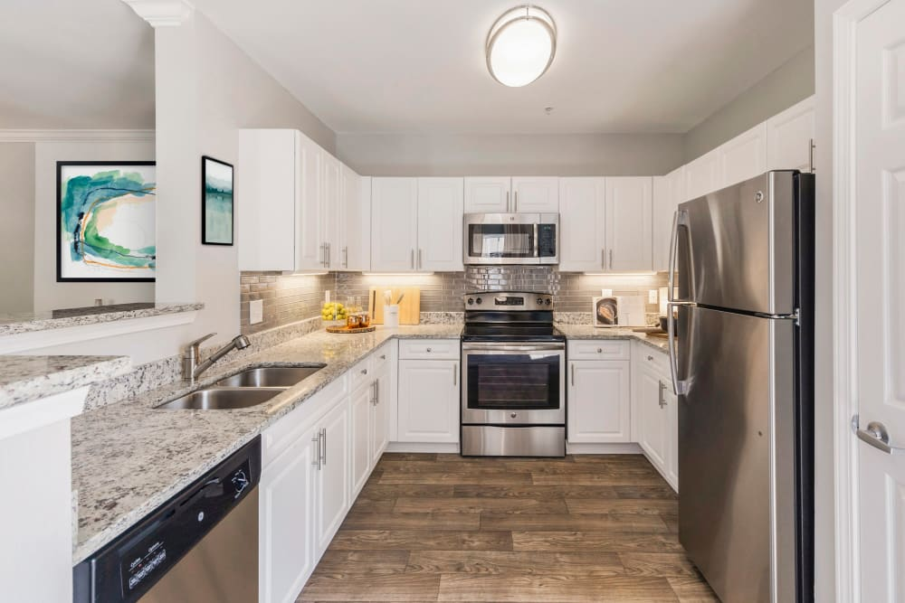 Kitchen with lots of counter space and new stainless steal appliances at Sofi at Salem Station in Salem, Massachusetts