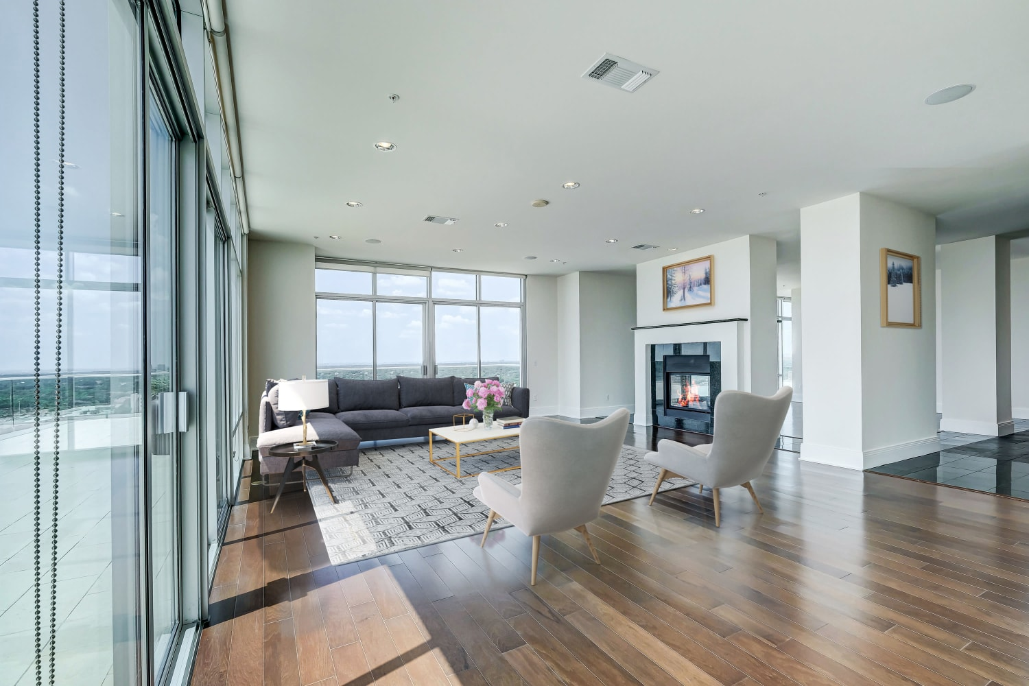 Spacious model living room at The Heights at Park Lane in Dallas, Texas
