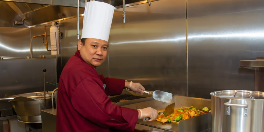 a chef cooking at Mission Healthcare at Renton in Renton, Washington.
