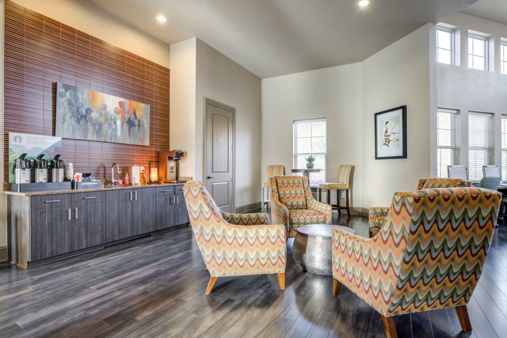Clubhouse cafe bar with comfortable seating for enjoying your morning coffee at The Addison at South Tryon in Charlotte, North Carolina